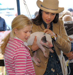 Kirstie holds a piglet - picture courtesy of the Nidderdale Show