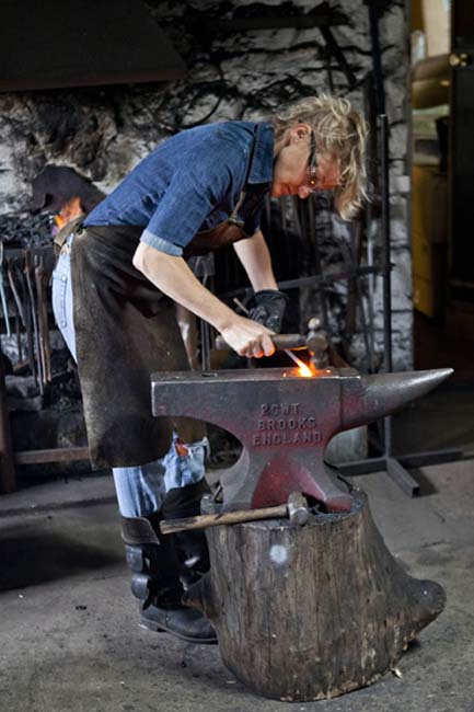 Artist-blacksmith Annabelle Bradley at work in her forge - photograph courtesy of NYOS