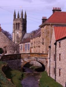 A pretty beck and fine old bridge