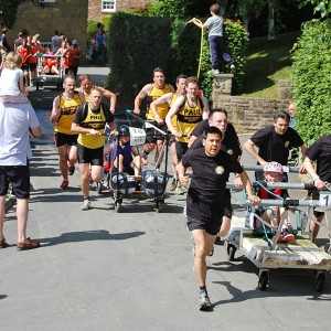 3 bed race teams running one after another
