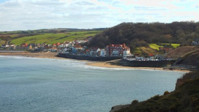 Looking back to Sandsend from the cliff top. The car park is on the right and at the top right you can see part of the former railway station.