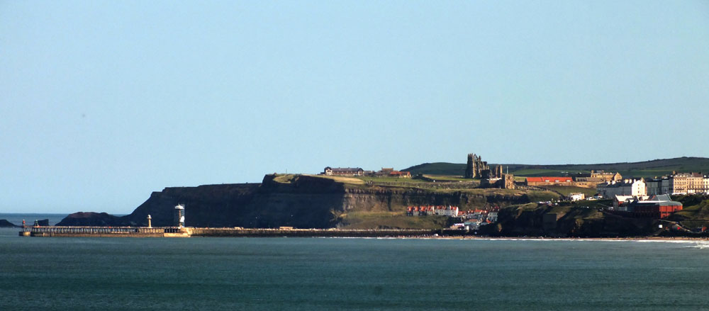 Whitby Abbey overlooks St Mary's Church, which itself overlooks the town and its harbour.
