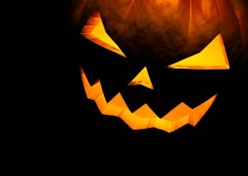 Jack O Lantern halloween pumpkin on black background. Close up with copy space. 3d render