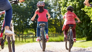 image of children and parents riding bikes on a family friendly cycle route