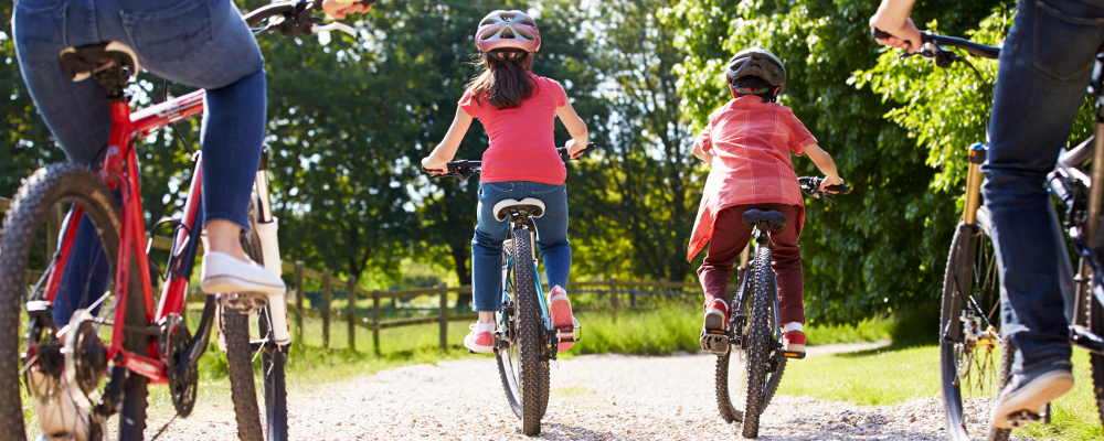 image of children and parents riding bikes on one of the family friendly cycle routes in the Dales
