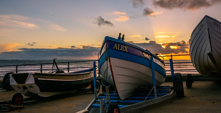boats at sunset in Filey