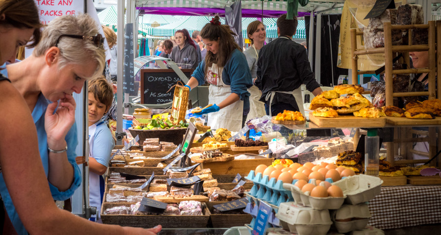 people looking at stalls at the Malton Harvest Food Festival