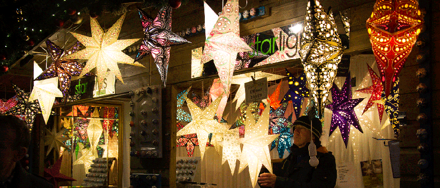 Chirstmas market stall selling lights