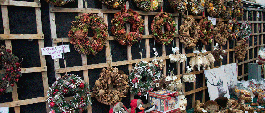 Christmas market stall with wreaths