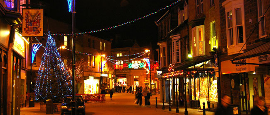 Harrogate street at night decorated with Christmas lights