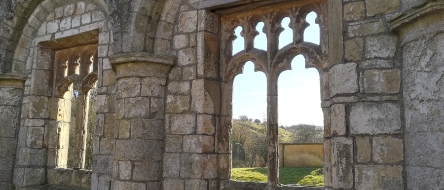 Wharram Percy medieval village church wall and window