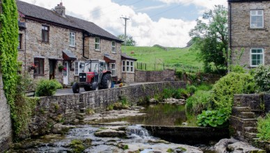Hawes town with tractor and stream