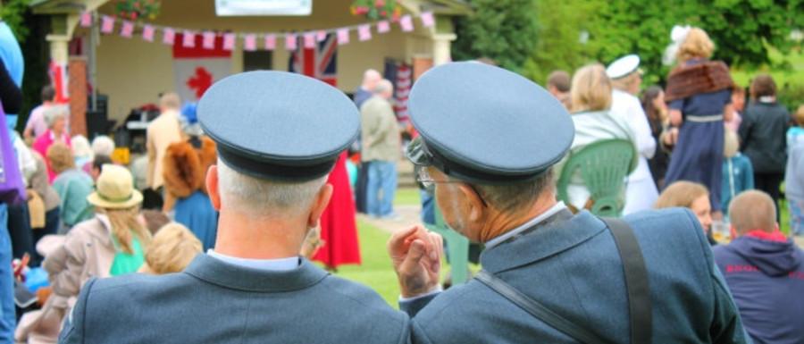 men sitting in uniform at a 1940s day in Harrogate
