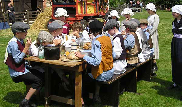 Children having a historic meal at the Ryedale Folk Museum