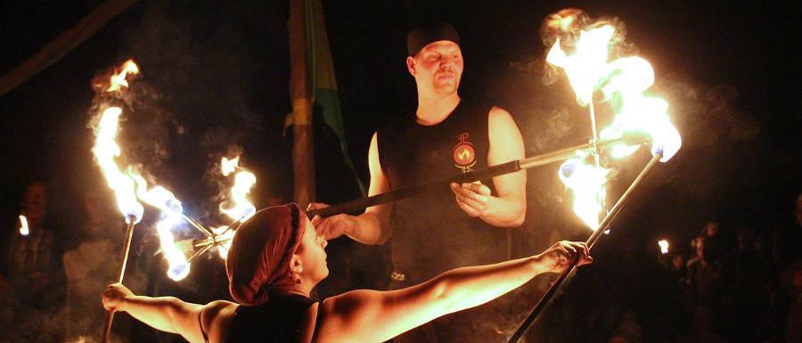 fire dancers with flaming poles